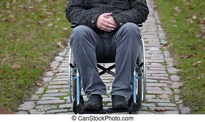 Disabled man sitting on wheelchair