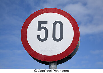 Fifty Traffic Speed Limit Sign on Blue Sky Background