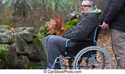 Disabled man talking with assistant