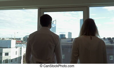 Business People Coming to the Window - Two business people...