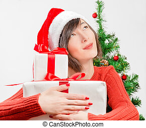 Presents for the new year - Young woman dreams about gifts...