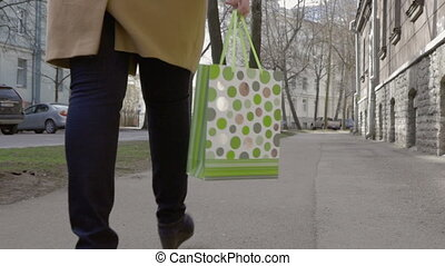 Woman Legs Walking With Colorful Shopping Bag - Steadicam...