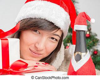 Woman in santa hat smiling