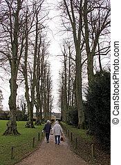 Two women walking down a path