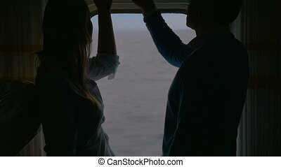 Couple Looking Out the Ferry Window - Slow motion shot of a...