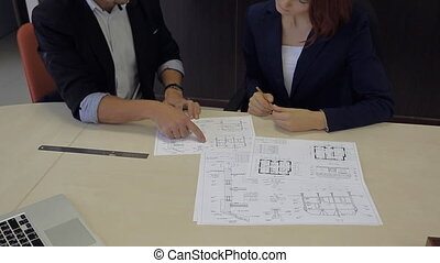 man and woman develop a plan. bank robbers professionals -...