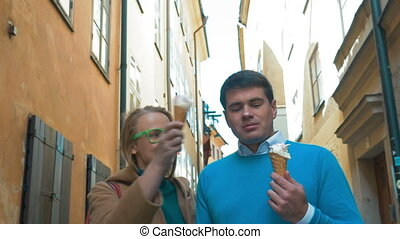 Couple Walking and Eating Ice-Cream
