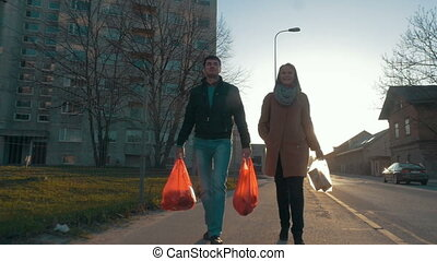 Couple Going Home after the Shopping - Steadicam slow motion...