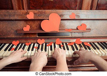 Couple in love playing on piano - Couple is playing on piano...