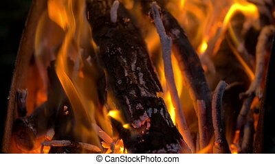 Blazing Campfire Coals In The Evening - Slow motion clip of...