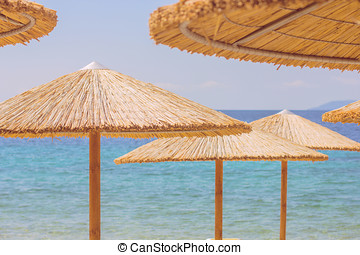 Summer Travel Destination Beach - Sunshade and Chairs on the...
