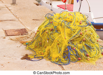 Traditional Fishing Tackle, net on the shore in port.