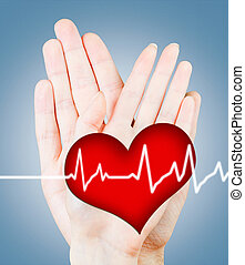 Loving beating heart on background of male and female hands
