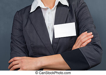 Nametag, space for text - Unrecognizable businesswoman with...
