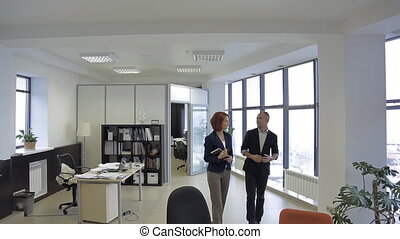 member of the press, journalist, talk with the person, which is interesting to readers in his office.