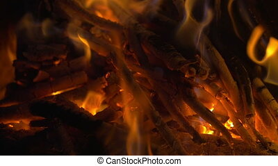 Wooden Sticks on Fire and Ash in the Fireplace - Slow motion...