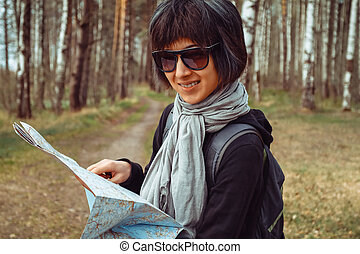 Woman tourist with map