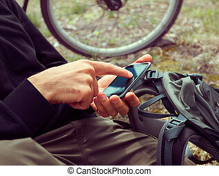 Cyclist searches GPS coordinates - Unrecognizable man...