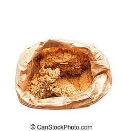 Top view of fried chicken in brown paper bag isolated on white