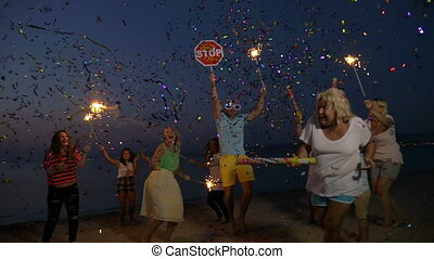 New Year party on the beach - Slow motion clip of happy and...
