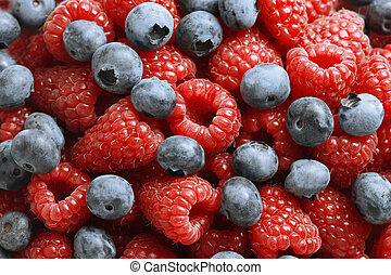 Close-up of fresh mixed berries - Delicious blueberries and...