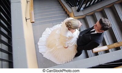 Just married couple on stairs - High angle shot of a just...