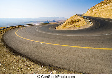 Hairpin bend in desert - A hairpin bend on a road in the...