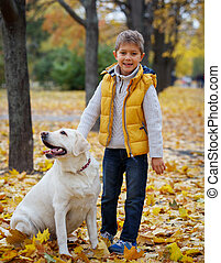 Boy with his dog labrador - Cute little boy with his dog...