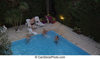 Family in the swimming pool on resort - High angle slow...