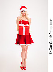 Seductive young woman in red santa claus dress and hat -...