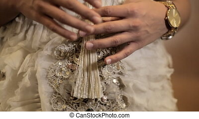 Brides play with wedding dress - Detail of a brides hands...