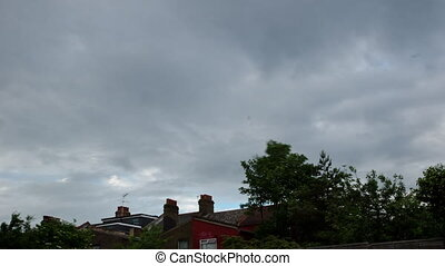 Time Lapse clouds and trees in a suburb of London