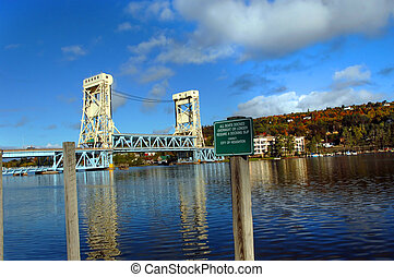 Drawbridge and Morning reflection - Portage Lake reflects...