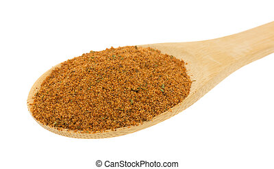 Wood spoon filled with dry chipotle pepper marinade...