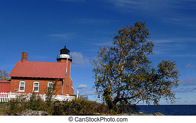 Guarding Lake Superior - Eagle Harbor Lighthouse stands...