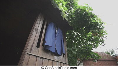 blue jacket hanging on the wood background hd