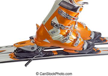 Alpine ski boots in ski binding closeup - Orange alpine ski...