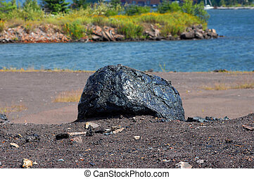 Copper Slag Rock - Copper slag rock sits on shore of Portage...