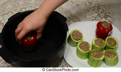 Woman prepares stuffed vegetables in Multicooker - Woman...