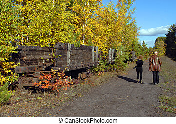 Amble besides Coal Cars - Couple explore a backroad above...