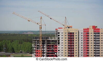 Building construction site with cranes. HD