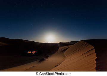 Bedouin nomad tent camp in Merzouga dunes, Morocco