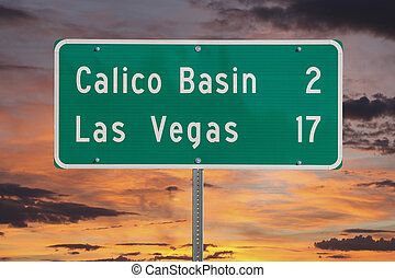 Las Vegas Highway Sign with Sunset Sky