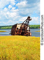 Abandoned Dredge - Sitting in the shallows of Torch Lake, a...