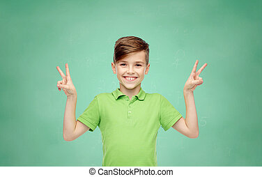 school boy showing peace or victory hand sign - gesture,...