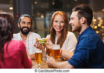 friends eating pizza with beer at restaurant - leisure, food...
