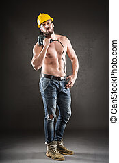 Portrait of attractive shirtless workman with drill -...