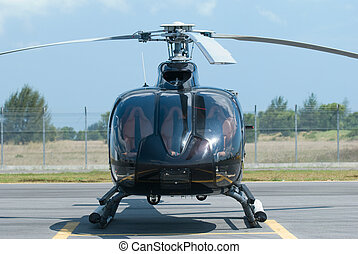 Black helicopter - Front view of black helicopter at an...