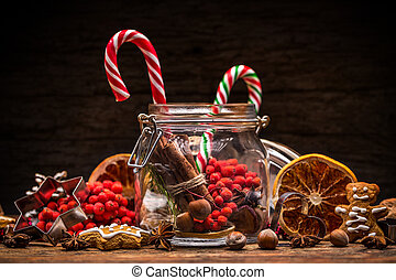 Christmas concept with candy, gingerbread and red berries