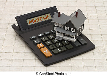 Home Mortgage, A gray house and calculator on stone background